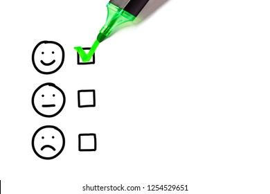 Green marker putting check mark on blank excellent survey checklist next to drawn happy face. Customer satisfaction concept.
