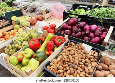 Green market with crates full with fresh fruits and vegetables