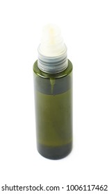 Green massage oil bottle isolated over the white background