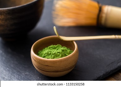 green matcha tea prepearing on stone black table