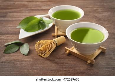 Green matcha tea set on wooden background
