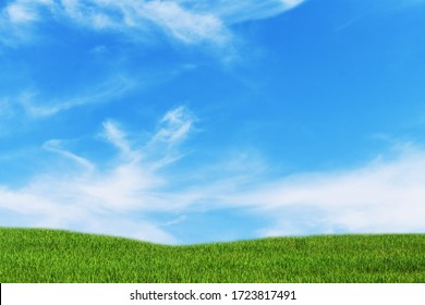 Green meadow with blue sky and clouds background