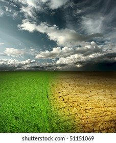 Green meadow and cracked desert land under storm clouds