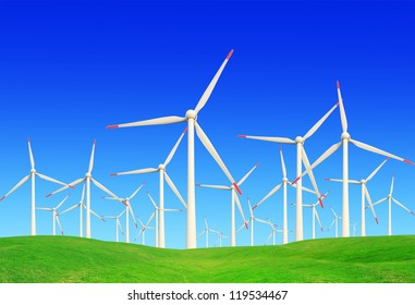 green meadow with Wind turbines generating electricit