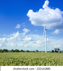 Green meadow with Wind turbines generating electricity In Thailand