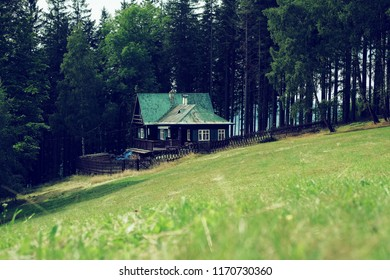 Green meadow with wooden cottage at Beskid Mountains. Czech Republic 2018.
