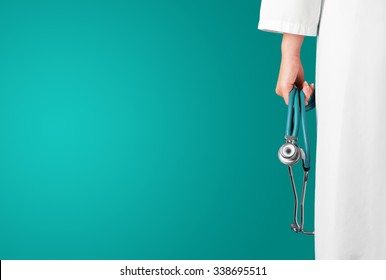 Green medical background with female doctor and stethoscope