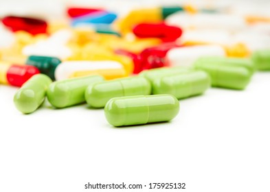 green medical pill capsule on white background
