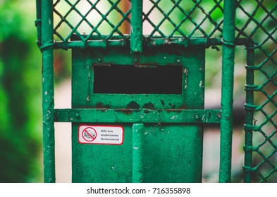 Green metal mailbox with a German sticker forbidding adverts and leaflets
