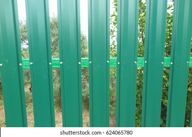 Green metal picket fence