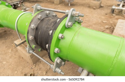 Green metal pipe flanges with bolts and flex