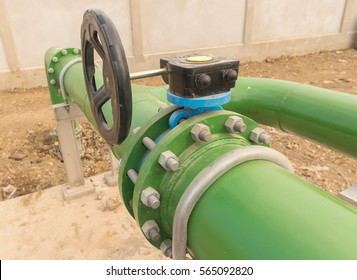 Green metal pipe flanges with bolts and valves,Pipeline at power plant