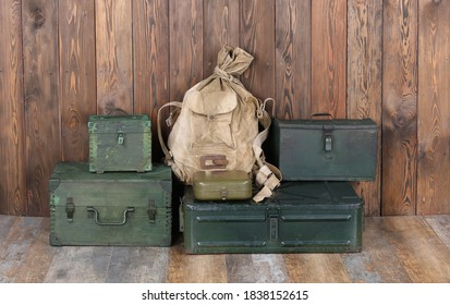 green military boxes on a wooden background