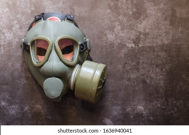 Green military gas mask for protection.