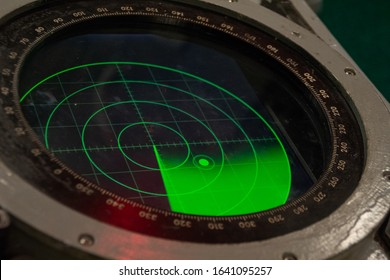 Green military radar screen with unknown target dot - Safety equipment.