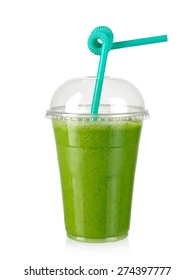 Green milk smoothie in a plastic cup