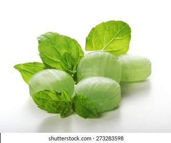 Green mint candies on white bacground