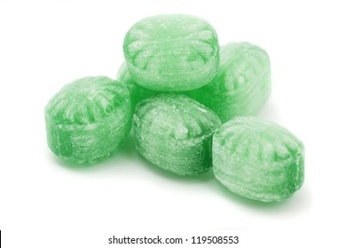 Green mint candy isolated on white background