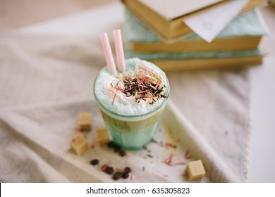 Green mint coffee with with cream and colorful decoration. Milk shake, cocktaill, frappuccino.  Unicorn coffee, unicorn food.