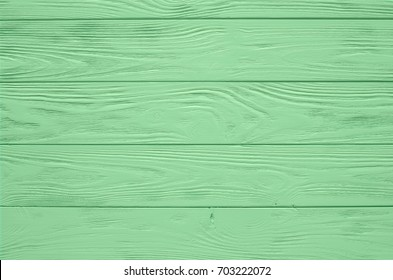 Green mint painted wood board texture and background. Green mint natural wooden background. Aged wood planks pattern. Wooden surface. Wooden barn. Green mint color wood barn. Woodboard background.