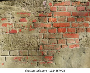 Green mint rock wall with red bricks