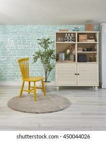 green mint wall with yellow chair sideboard on wood floor-interior