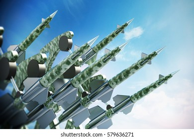Green missiles aimed for the sky. 3D illustration.