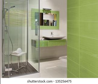 green modern bathroom with a big shower a washbasin