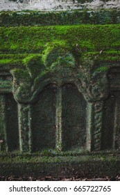 Green mos on the wall of old pagoda in Thailand,The beauty that comes from the integrity of the environment.
