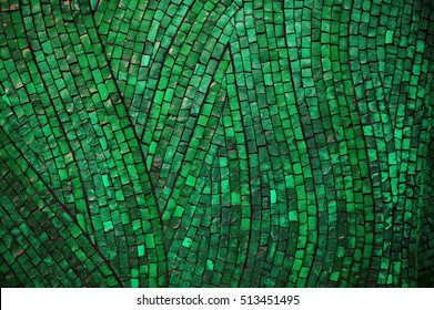 green mosaic texture on the wall