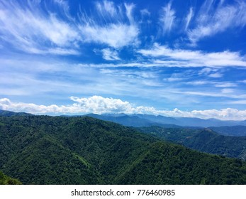 Green mountain chain under blue sky with clouds in Turkey's Rize
