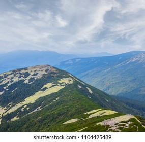 green mountain chains under a cloudy sky