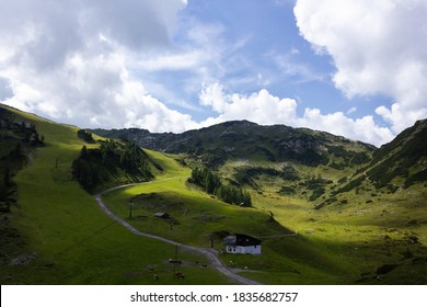 Green mountain slope with fair weather, hiking trail and skilift in Altenmarkt im Pongau (Salzburg county, Austria)