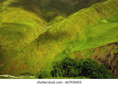 Green mountain slopes in different shades of the sun