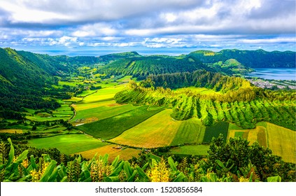Green mountain valley agriculture fields. Agriculture mountain valley fields landscape. Agriculture valley fields in mountains. Agriculture mountain valley field landscape