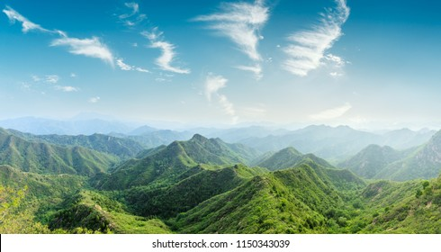 Green mountains and beautiful sky clouds under the blue sky