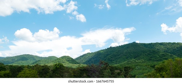 Green mountains and beautiful sky clouds under blue sky. Outdoor landscape for natural background.