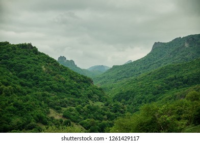 green mountains with clouds