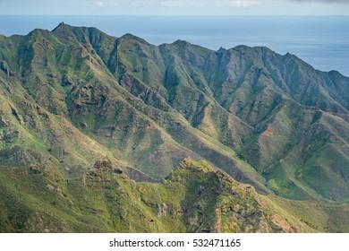 Green mountains, forest landscape, ocean background