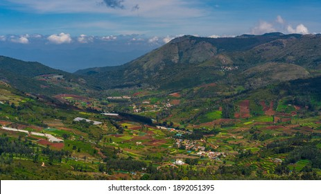green mountains landscape with sky and clouds of Ooty Villagge . Ooty or Ootacamund or Udhagamandalam is a popular hill station in India