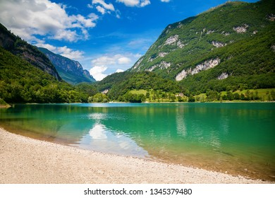 green mountains and Tenno lake with transparent water, Trentino, Italy