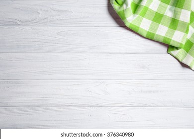 green napkin on the old wooden table.
