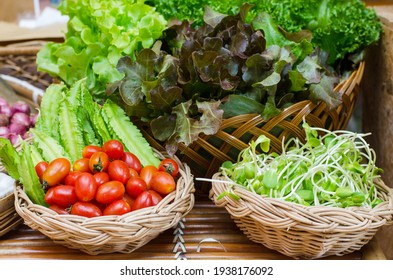 green natural organic ingredient herbs vegetables thailand spice with tomato, sprout sunflower and other on table in kitchen.