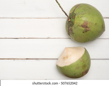 Green  natural tropical fruit  coconut on white wood  background.