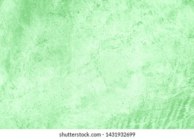 Green neo mint color gradient background. Concrete or beton pattern