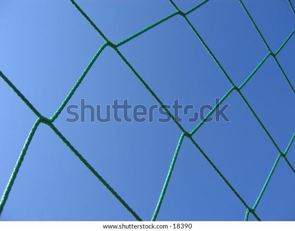 Green net of a soccer goal.