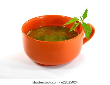 Green nettle soup isolated on white background.