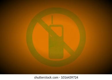 green no mobile phone allowed sign painted on apricot leather texture background