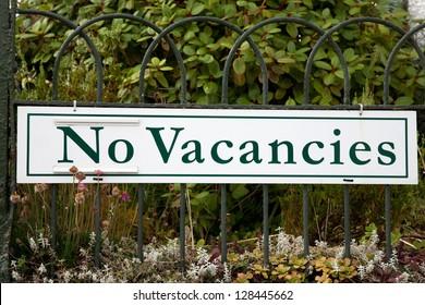 Green No Vacancies Sign in Rural Setting