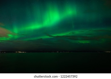 Green northern lights above Trondheimsfjorden in Ranheim, Trondheim area, Norway.